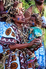 Tender moments. (Ian Ramsay Photographics) Tags: tendermoments young mother member cultural singing groups performance daughter child lifou loyaltyislands newcaledonia