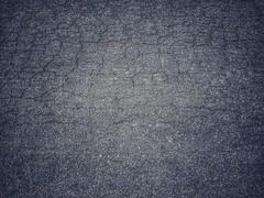 Asphalt road surface (naatoy) Tags: concrete road asphalt surface black backdrop gray street texture detail closeup way background dark tar bitumen rough pavement tarmac stone dirty structure pattern old roadway transportation grain material urban wallpaper construction grainy grunge cement close abstract ground textured rock highway transport granular grey space paving sidewalk design traffic new dry