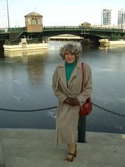 Folks, There Is Something I Told You A Long Time Ago That I Believe Is Still Quite Relevant (Laurette Victoria) Tags: trenchcoat purse woman laurette downtown milwaukee gloves