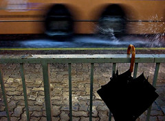 "retrospective: ""the moment right before I got wet"" (2006) (hugo poon - one day in my life) Tags: f30 fujifilm hongkong central citynight rainy bus cityhall umbrella wet splash crazy reminiscing retrospective"