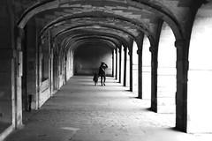 Under the old arches (pascalcolin1) Tags: paris femme woman enfant child arches lumière light ombres shadows photoderue streetview urbanarte noiretblanc blackandwhite photopascalcolin 50mm canon50mm canon