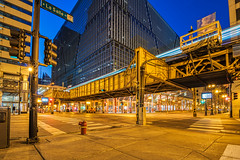 A Morning in Chicago #6 (tquist24) Tags: chicago chicagoloop eltrain hdr illinois nikon nikond5300 outdoor bluehour city cityscape downtown geotagged intersection lights longexposure outside railroad sky starburst street streetphotography tracks train building buildings