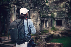 Female tourist standing between columns in ancient temple ruins on Ta Prohm (Patrick Foto ;)) Tags: adult adultsonly asianandindianethnicities beauty buildingexterior cambodianculture cultures famousplace females happiness landscapescenery oldruin oneperson onewomanonly oneyoungwomanonly onlywomen photography root siemreap siemreapprovince socialhistory stonematerial taprohmtemple templebuilding traveldestinations treasurechest unescoworldheritagesite vacations women youngadult ancient angkor architecture art asia buddhism cambodia history khmer monument old people photographer religion tomb tourism tourist travel tree wat