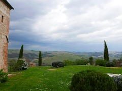 rain rolling in (ekelly80) Tags: italy tuscany april2019 spring countryside sangiovannidasso airbnb house yard outside sky light clouds rolling hills storm rain view green grass trees cypress
