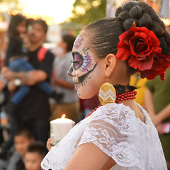 Preparing for the dance (radargeek) Tags: 2017 october dayofthedead plazadistrict okc oklahomacity facepaint candle kid child catrina