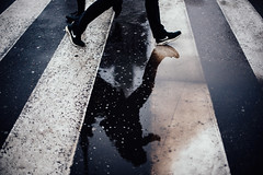 Puddles upon puddles (ewitsoe) Tags: 50mm nikon nikond750 rain spring street warszawa erikwitsoe everydaylife poland urban warsaw puddle reflection walking man shoes feet legs zebrastripes citylife pedestrian travel traveling wander