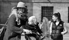 What She Left Behind (Photographer : Hans Stellingwerf) Tags: amsterdam damsquare streetphotography street nederland netherlands holland mensen people straatmoment straat straatfotografie straatportret streetportrait vrouw woman child kind bike fiets