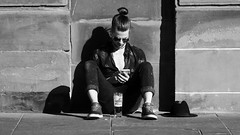 Who Needs a Seat When You Have the Sun 01 (byronv2) Tags: edinburgh edimbourg scotland blackandwhite blackwhite bw monochrome street candid peoplewatching shore theshore waterofleith river coast coastal rnbwaterofleith sunny sunshine spring drinking alcohol beer leith man trendy sitting cellphone phone mobilephone glass people sit seated