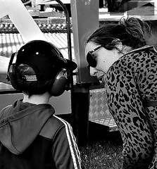 Are you listening to me? (ronramstew) Tags: carnival fair fairground forfar angus scotland bw blackandwhite 2019 2010s earphones woman boy