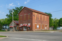 Building — Tarlton, Ohio (Pythaglio) Tags: building structure historic tarlton ohio unitedstatesofamerica twostory brick commonbond frontgabled threebay vacant segmentalarched windows boarded sealed metal stone lintels sills awnings sidewalk street trees cables wires pic7615 pickawaycounty