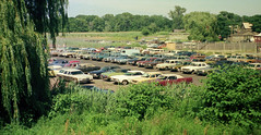 Afternoon shot of the Surf Club parking lot showing lots of colorful cars. Most are American, but a few foreign ones are also visible. How many can you name? Milford Connecticut. August 1974 (wavz13) Tags: oldphotographs oldphotos 1970sphotographs 1970sphotos oldphotography 1970sphotography vintagesnapshots oldsnapshots vintagephotographs vintagephotos vintagephotography filmphotos filmphotography vintagemilford oldmilford 1970smilford vintagewoodmont oldwoodmont 1970swoodmont oldcars vintagecars 1960scars 1970scars collectiblecars collectablecars antiquecars connecticutphotographs connecticutphotos connecticutphotography oldconnecticutphotography oldconnecticutphotos 110film kodacolor analogphotography instamatic pocketinstamatic surfvillage sandpipercrescent