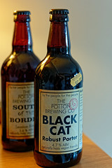 Bottle of Black Cat (Robust Porter) by the Potton Brewery (Panasonic Lumix S1 & 24-105mm f4 Zoom) (markdbaynham) Tags: beer cerveza birra ale craftbeer realale pottonbrewery bottle glass label panasoniclumix lumix lumixs lumixer 24105mm 24105mmf4 s1 panasonics1 lumixs1 panasoniclumixs1 mirrorless mirrorlesscamera mirrorlessfullframe fullframe ff fx panasonicmirrorlesscamera fullframemirrorless pottonbeer