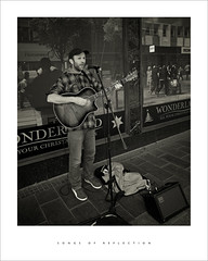 Songs of reflection (Parallax Corporation) Tags: busking guitar southport houghtonstreet shoppingarcade sonya7rii sonygmaster24mmf14 blackwhite monochrome streetphotography candid rolandamplifier