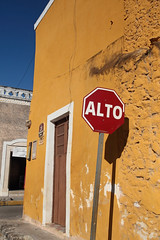 Alto (peterkelly) Tags: digital northamerica canon 6d gadventures mayandiscovery yucatán izamal mexico yellow road street stop sign alto red encarnado building wall door