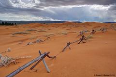 Barrier (walkerross42) Tags: coralpinksanddunes sand dunes sanddunes fence rails storm thunderstorm clouds statepark utah buried desert