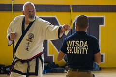 Mr. A helps out with a demo (TheBurgners) Tags: tournament wtsda sanfrancisco missionhigh paresh tang soo do