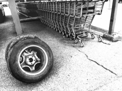 Discarded (Cindy's Here) Tags: discarded tires carts grocerystore thunderbay ontario canada iphone bw 52in2019challenge 26