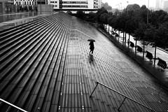 Going down to the road (pascalcolin1) Tags: paris13 femme woman pluie rain reflets reflection lumière light parapluie umbrella escalier stairs route road photoderue streetview urbanarte noiretblanc blackandwhite photopascalcolin 50mm canon50mm canon