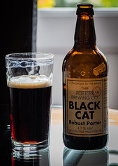 A  Cat That I Am Not Alergic To (Black Cat Robust Porter from the Potton Brewery) (Olympus OM-D EM1.2 & M.Zuiko 12-100mm f4 Pro Zoom) (markdbaynham) Tags: beer birra cerveza craftbeer ale realale bottle blackcat porter darkbeer 12100mm 12100mmf4 zoomlens prozoom olympusmft olympusomd omd olympuspro olympusprolens em1 em12 em1ii em1mk2 em1mark2 mirrorless micro43 microfourthird microfourthirds mirrorlesscamera pottonbrewery mzd zd mzuiko zuikolic zuikozoom m43 m43rd