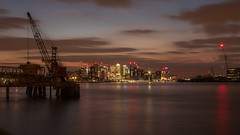 Cranes and Canary in London (- Andy B) Tags: canary wharf london thames river lights night time cranes sunset dusk long exposure reflections red