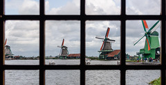 Shop Window Windmills (Brett of Binnshire) Tags: historicalsite museum zaandam netherlands window river locationrecorded water shop architecture windmill clouds weather store zaanseschans building stream northholland