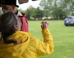 Examining a meteorite against the backdrop of rain