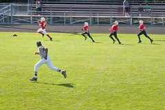 kids playing football - Running for a touchdown with  three other players from the opposing team chasing behind. (thstrand) Tags: inpursuit youth youngkids strides stride defenders defending defender man adultmale boys americanfootball peeweefootball sprinting sprint warmday autumn fall footballfield kid fourpeople speedy speed runningback players player runningdown chasing chase running run referees referee ref sidelines sideline touchdowns touchdown scoring score breakingloose teams team games game defense offense football sports sport playing children childhood child kids
