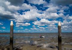 Krabbendijke (Omroep Zeeland) Tags: krabbendijke oosterschelde vissersbootje laag water eb slik wolkenlucht meerpalen meerpaal