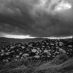 Stormcloud over stonewall (Ian@NZFlickr) Tags: otago peninsula dry syonewall driving rain mud stormcloud dunedin nz