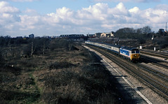 NSE 50032 hauls a Sunday Oxford-London Paddington service past Old Oak Common on 15 February1987. The waste land on the left became the site of North Pole TMST depot, itself now redundant and used for maintenance of electric stock. Tempus Fugit! (mikul44171) Tags: tmst oldoak northpole 50032 february1987 wasteland