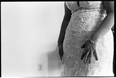 LisaJason10.13.18_079 (Johnny Martyr) Tags: wedding marriage bride bridal she her woman female feminine body shape curves curvy dress hands shapely hips detail ready prepare prebridal love romance white gown ring jewelry bracelet silver lace tight form fit hug snug lines bw black film 35mm leica letiz leitz 5cm 50mm summitar kodak trix 1600 window light room arm arms move suggestion m6 hc110 grain