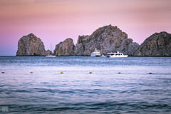 Cabo Landsend at Dusk 1 (lycheng99) Tags: cabo cabosanlucas mexico california californiacoast baja bajacalifornia bay rocks rockformation mountains sky dusk colorfulsky water nature travel explore landscape landsend