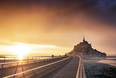 Le Mont Saint Michel Sunset (Bernd Schunack) Tags: mont saint michel sunset france bretagne normandie fantastic light silhouettes bridge perspective water sea sky clouds rain panasonic lumix gx9 dramatic beach