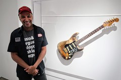 Tom With Stevie Ray Vaughan Guitar (edenpictures) Tags: playitloud instrumentsofrockroll metropolitanmuseumofart themet exhibit exhibition show guitar musicalinstrument tommorello