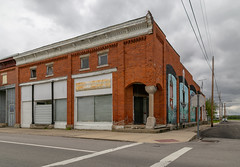 Building — Miller City, Ohio (Pythaglio) Tags: building structure historic millercity ohio unitedstatesofamerica onestory brick putnamcounty classicalrevival ca1900 italianate brackets dentils cornice altered remodeled mural storefronts vacant recessedbays