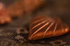 The heart of the matter... (judi may) Tags: macromonday macro macromondays copper heart hearts metal lace bokeh dof depthoffield blur stilllife tabletopphotography canon5d lowkey lowlight