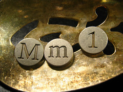 Macromondays is #1 (muffett68 ☺ heidi ☺) Tags: mm macromondays aspoonful hmm metal buttons slotted spoon sepia tones tarnish