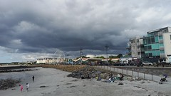 Dark Sky over Salthill (mcginley2012) Tags: darkcloud clouds salthillprom galway ireland beach coast funfair ferriswheel
