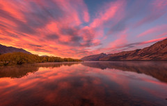 Explosion (inkasinclair) Tags: sunrise glenorch new zealand south island landscape reflection clouds colour