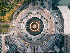 Top view of the Fountain of Wealth as the largest fountain in the world at Singapore. It is located in one of Singapore largest shopping malls. (MongkolChuewong) Tags: aerial aerialview air architecture art asia bridge building circle city cityscape color downtown drone famous finance fly fountain harbor high junction landmark landscape largest located malls modern night ocean office performance rich ring shopping show singapore singaporecity skyscraper structure suntec tall top tourism tower town travel urban view water wealth centralregion