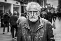 Stop, Look and Listen (Leanne Boulton) Tags: urban street candid portrait portraiture streetphotography candidstreetphotography candidportrait streetportrait eyecontact candideyecontact streetlife old man male face eyes expression emotion mood piercing gaze stare glasses beard style fashion tone texture detail depthoffield bokeh naturallight outdoor light shade city scene human life living humanity society culture lifestyle people canon canon5dmkiii 70mm ef2470mmf28liiusm black white blackwhite bw mono blackandwhite monochrome glasgow scotland uk