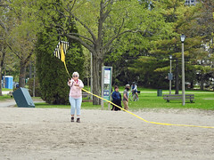 Thérèse launching her husband's (Al), kite at the Britannia Bay beach in Nepean (Ottawa), Ontario (Ullysses) Tags: thérèseandal kite flyingakite albert britanniabaypark britanniabaybeach spring printemps ottawariver rivièredesoutaouais nepean ottawa ontario canada cerfvolant beach plage candidphotography candid