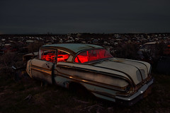 lost on a sea of rust. 2015. (eyetwist) Tags: eyetwistkevinballuff eyetwist night trunk junkyard cold dark longexposure long exposure clouds overcast fullmoon desert nikon nikond7000 d7000 nikkor capturenx2 1024mmf3545g 1024mm npy nocturne lightpainting flashlight gels color red highdesert americana americantypology american typology empty wasteland shadows abandoned desolate lonely car cars autos classic rust rusty junk wrecked derelict decay patina faded idaho taillight bumper chrome trunklid weeds dented dinged rusted rearwindow goat wheels landscape 1958 chevy chevrolet