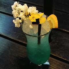 All I know is it's #blue & #refreshing on a 93° day.  #floral #fragrant #garnish #icecold #cocktail #cheers #🍹 (Heath & the B.L.T. boys) Tags: instagram drink cocktail flowers