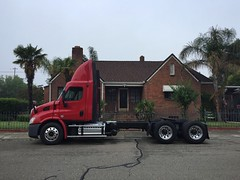 Bringing The Office Home With You (misterbigidea) Tags: yard brickhouse truck trucker red neighborhood scenic street parked bigrig semitruck peterbilt hotwheels urban lifestyle morning