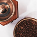 Coffee mill and cup with beans on white background