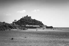 St Michael's at low tide (Through_Urizen) Tags: category cornwall england places seascape stmichaelsmount canon1585mm canon70d canon outdoor travelphotography landscapephotography sea beach water tide rock stone tourist island hill church building uk unitedkingdom coast coastal seashore sand sky