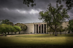 Eisenhower Presidential Library (donnieking1811) Tags: kansas abilene eisenhowerpresidentiallibrary library dwightdeisenhower architecture building exterior sign flag usflag americanflag trees sky clouds hdr canon 60d lightroom photomatixpro
