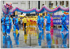 How To Train Your Dragon (donbyatt) Tags: london trafalgarsquare dancing rain wet falungong chinese people candid street reflections dragon
