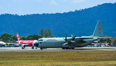 Aircraft taxiing on runway of Langkawi Airport (phuong.sg@gmail.com) Tags: aeronautical airlift c130 combat defence force four lockheed propellers war aeroplane aerospace air airborne aircraft airforce airplane airport armed army aviation blue cargo defense delivery engines flight fly forces freight hercules jet landing langkawi lift lima logistics military plane royal thai thailand transportation weapon